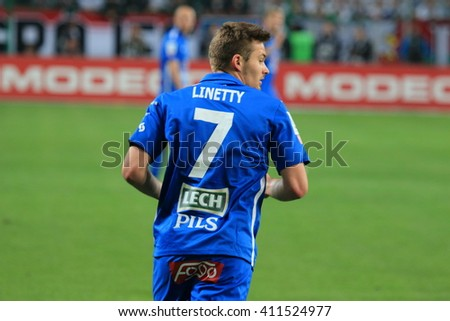 WARSAW, POLAND - APRIL 15, 2016: Karol Linetty (Lech Poznan) in action during polish league football match between Legia Warszawa and Lech Poznan in Warsaw.  - stock photo