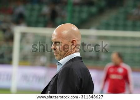 WARSAW, POLAND - AUGUST 27, 2015: Henning Berg, Legia Warsaw coach before UEFA Europe League qualifications football match between Legia Warsaw (Poland) and Zoria Lugansk (Ukraine) in Warsaw. - stock photo