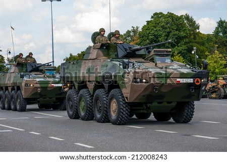 WARSAW, POLAND - AUGUST 15, 2014: Polish Wolverine. Rosomak KTO - Wheeled Armored Vehicle. Polish Armed Forces Day. 1200 Polish and over 90 foreign soldiers, over 120 military vehicles, 50 aircraft - stock photo