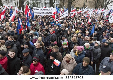 WARSAW, POLAND - DECEMBER 3, 2015: Polish democracy activists demonstrate against the hijacking of the Polish political scene by the governing party in Warsaw, Poland.  - stock photo