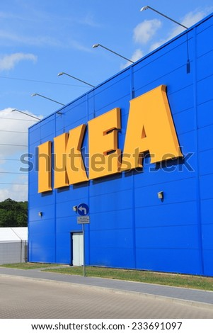 WARSAW, POLAND - JULY 12, 2014: Front entrance of IKEA store. Ikea is the world's largest furniture retailer and sells ready to assemble furniture. - stock photo