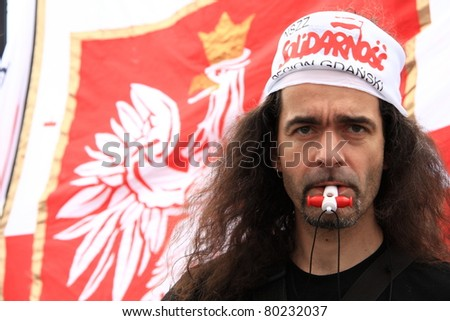 WARSAW, POLAND - JUNE 30: An unidentified man taking part in anti government Solidarity demonstration on June 30, 2011 in Warsaw, Poland. - stock photo
