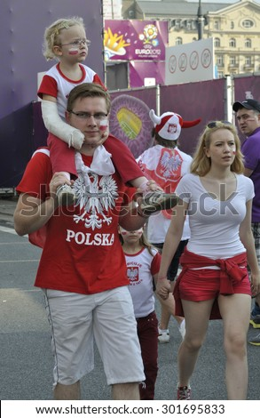 WARSAW, POLAND - JUNE 8, 2012 - Poland fans at the Warsaw fan zone during the UEFA EURO 2012 Group A - match against Greece. - stock photo