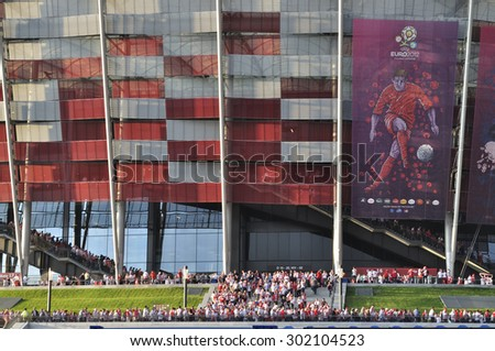 WARSAW, POLAND - JUNE 8, 2012 - Poland fans outside the National Stadium after the UEFA EURO 2012 Group A match against Greece. - stock photo