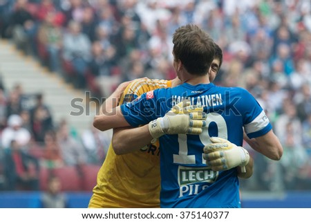 WARSAW, POLAND - MAY 02, 2015: Dusan Kuciak (Legia Warsaw) and Kasper Hamalainen (Lech Poznan) during Polish Cup final football match between Legia Warsaw and Lech Poznan in Warsaw. - stock photo