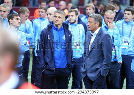 WARSAW, POLAND - MAY 27, 2015: FC Dnipro players and staff react after lose the Final game of UEFA Europa League against FC Sevilla at Warsaw National Stadium - stock photo