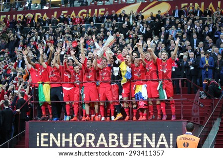WARSAW, POLAND - MAY 27, 2015: FC Sevilla players celebrate their winning of the UEFA Europa League 2015 after the game against Dnipro at Warsaw National Stadium - stock photo