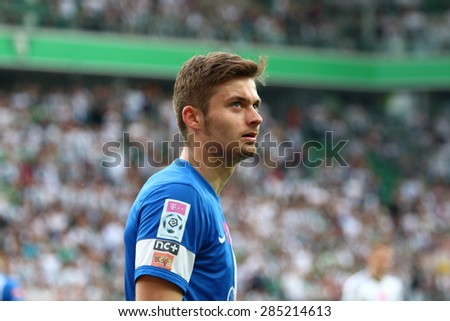 WARSAW, POLAND - MAY 09, 2015: Karol Linetty, Lech Poznan midfielder during Polish League football match between Legia Warsaw and Lech Poznan in Warsaw. - stock photo