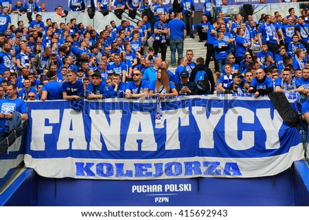 WARSAW, POLAND - MAY 2, 2016: Lech Poznan fanatical fans during Polish Cup final football match between Legia Warszawa and Lech Poznan at the National Stadium in Warsaw. Legia - Lech 1:0 - stock photo