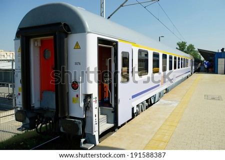 WARSAW, POLAND - MAY 1: Passenger express train on May 1, 2014 at Warsaw East railway station, Poland. The train is owned by PKP Intercity, the Polish largest railway operator. - stock photo