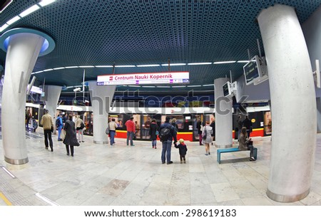 WARSAW, POLAND - MAY 27, 2015: Passengers waiting train at Centrum Nauki Kopernik metro station in Warsaw. Station was opened in March 2015 as part of the 2nd line of Warsaw Subway system - stock photo