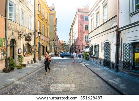 Warsaw, Poland - May 17, 2013. Street panorama in Warsaw, Poland, Europe. Famous and interesting place for tourism. Old Town in Warsaw, Poland. UNESCO World Heritage Site. - stock photo