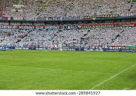 WARSAW, POLAND - MAY 02, 2015: Unidentified fans of Legia Warsaw during Polish Cup Final football match between Legia Warsaw and Lech Poznan at the National Stadium in Warsaw. - stock photo