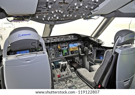 WARSAW, POLAND - NOVEMBER 16: Cockpit view of the new Boeing 787 Dreamliner - First Dreamliner purchased by Polish national carrier LOT - on November 16, 2012 in Warsaw, Poland. - stock photo