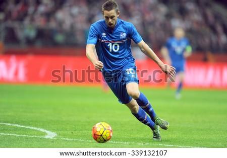 WARSAW, POLAND - NOVEMBER 13, 2015: EURO 2016 European Championship friendly game Poland - Iceland o/p Gylfi Thor Sigurdsson  - stock photo