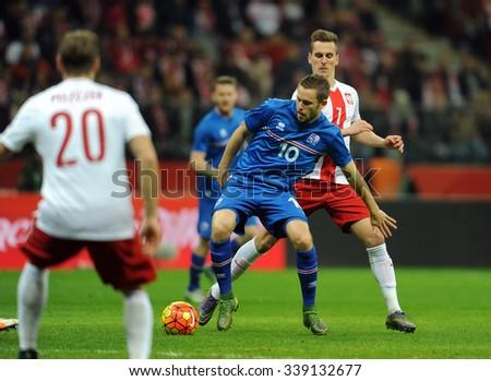 WARSAW, POLAND - NOVEMBER 13, 2015: EURO 2016 European Championship friendly game Poland - Iceland o/p Arkadiusz Milik Gylfi Thor Sigurdsson  - stock photo