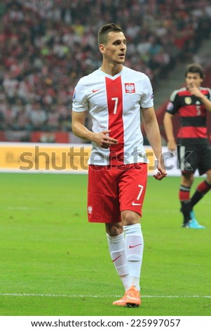 WARSAW, POLAND - OCTOBER 11, 2014: Arkadiusz Milik in action (Polish team and Ajax Amsterdam player) during the UEFA EURO 2016 qualifying match of Poland vs. Germany - stock photo