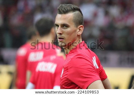 WARSAW, POLAND - OCTOBER 11, 2014: Arkadiusz Milik (Polish team and Ajax Amsterdam player) before the UEFA EURO 2016 qualifying match of Poland vs. Germany. Milik scored the opening goal in a 2�0 win. - stock photo