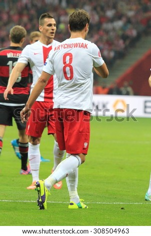 WARSAW, POLAND - OCTOBER 11, 2014: Grzegorz Krychowiak (Polish team and Spanish club FC Sevilla defensive midfielder) during the UEFA EURO 2016 qualifying match of Poland vs. Germany.  - stock photo