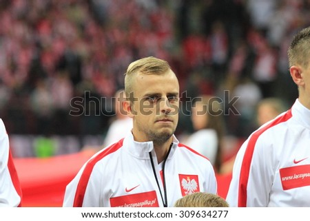 WARSAW, POLAND - OCTOBER 14, 2014: Kamil Grosicki (Polish team and French club Stade Rennais winger) before the UEFA EURO 2016 qualifying match of Poland vs. Scotland. - stock photo