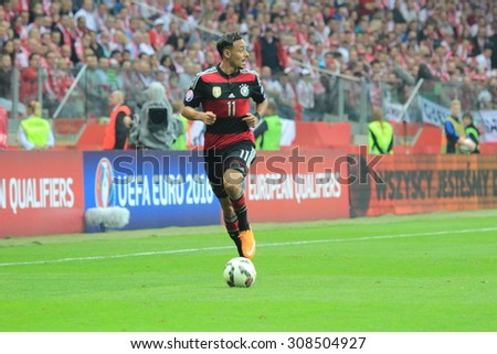 WARSAW, POLAND - OCTOBER 11, 2014: Karim Bellarabi (German team and Bundesliga club Bayer Leverkusen winger) before the UEFA EURO 2016 qualifying match of Poland vs. Germany.  - stock photo