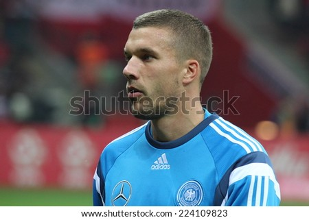 WARSAW, POLAND - OCTOBER 11, 2014: Lukas Podolski (German and Arsenal London player) before the UEFA EURO 2016 qualifying match of Poland vs. Germany. Poland beat Germany 2:0 - stock photo