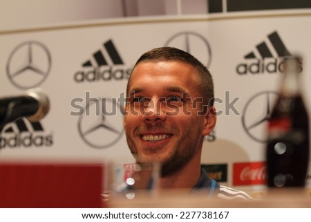 WARSAW, POLAND - OCTOBER 10, 2014: Lukas Podolski, German national football team and Arsenal London player attends a press conference before the UEFA EURO 2016 qualifying match of Poland vs. Germany.  - stock photo