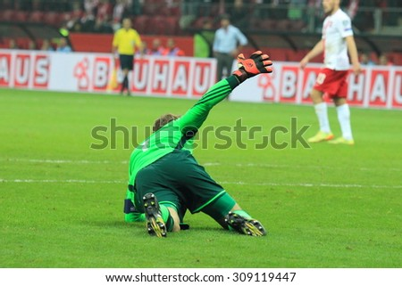 WARSAW, POLAND - OCTOBER 11, 2014: Manuel Neuer (German team and Bundesliga club Bayern Munich goalkeeper) during the UEFA EURO 2016 qualifying match of Poland vs. Germany.  - stock photo