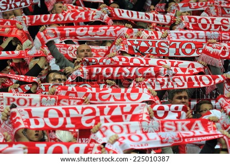 WARSAW, POLAND - OCTOBER 14, 2014: Polish fans in action during the UEFA EURO 2016 qualifying match of Poland vs. Scotland  - stock photo
