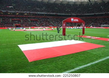 WARSAW, POLAND - OCTOBER 14, 2014: Polish flag on the grass of the National Stadium in Warsaw before the UEFA EURO 2016 qualifying match of Poland vs. Scotland  - stock photo