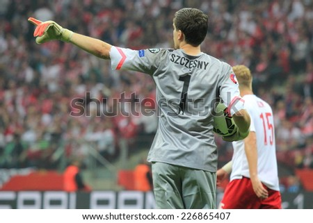 WARSAW, POLAND - OCTOBER 11, 2014: Wojciech Szczesny in action (Polish team and Premiership club Arsenal London goalkeeper) during the UEFA EURO 2016 qualifying match of Poland vs. Germany - stock photo