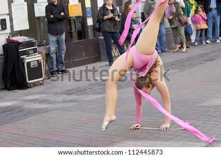 WARSAW, POLAND, SEPT 8: Rhythmic gymnastics show on the XV Pink Ribbon Walk against the Breast Cancer september 8, 2012 in Warsaw, Poland. - stock photo