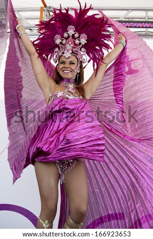 WARSAW, POLAND, SEPT 8: Unidentified Carnival dancers on the XV Ribbon Walk against the Breast Cancer september 8, 2012 in Warsaw, Poland. - stock photo