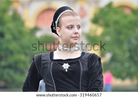 WARSAW, POLAND - SEPTEMBER 11, 2010 Dancer of the ensemble Gratia Iuvenis, showing of the Renaissance costumes, during of the Wilanow Days event. - stock photo