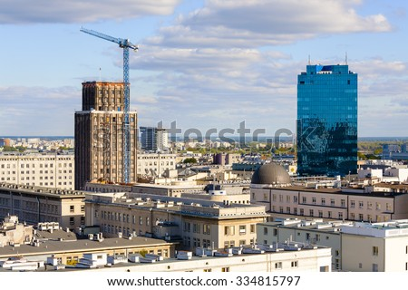 WARSAW, POLAND - SEPTEMBER 30, 2015: Skyscrapers in the city, on left built in the years 1931-1933 as the seat of English Insurance Company, on the right it is a 22-storey office building - stock photo