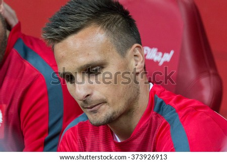 WARSAW, POLAND - SEPTEMBER 7, 2015: Slawomir Peszko (Poland) before the EURO 2016 qualification match between Poland and Gibraltar at the National Stadium on September 7, 2015 in Warsaw, Poland.  - stock photo