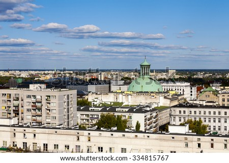 WARSAW, POLAND - SEPTEMBER 30, 2015: The dome of the church towering over the the city. The Evangelical-Augsburg, The Holy Trinity Church built in 1781, reconstructed in years 1949-1957 - stock photo