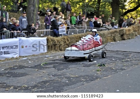 WARSAW, POLAND - SEPTEMBER 23: Unidentified competitor rides his homemade vehicle during the Red Bull Soapbox Race on September 23, 2012 in Warsaw, Poland. - stock photo