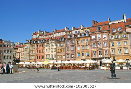 Warsaw's Old Town Market Place (Rynek Starego Miasta) on a sunny day, which is the center and oldest part of Warsaw - stock photo