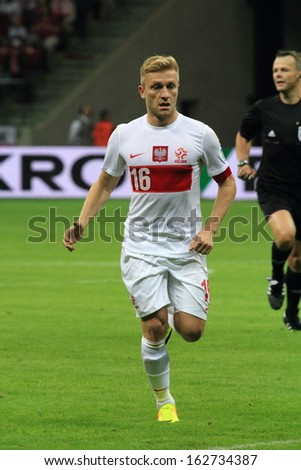 WARSAW - SEPTEMBER 6: Jakub Blaszczykowski (Poland) during the 2014 World Cup qualification match between Poland and Montenegro at the National Stadium on September 6, 2013 in Warsaw, Poland.  - stock photo