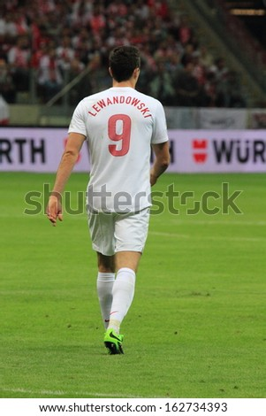 WARSAW - SEPTEMBER 6: Robert Lewandowski (Poland) during the 2014 World Cup qualification match between Poland and Montenegro at the National Stadium on September 6, 2013 in Warsaw, Poland.  - stock photo