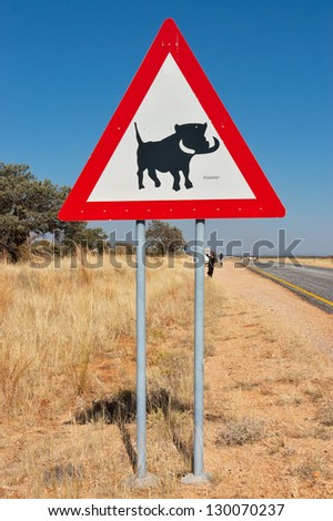 Warthog road sign in Namibia, animals of South Africa - stock photo