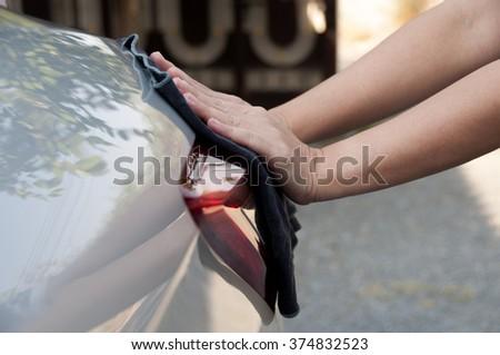 Wash a car auto mechanic worker polishing car bonnet  at automobile repair and renew service shop - stock photo