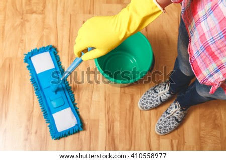 Wash wood floor mop. Housekeeping concept. A bucket of water and mop. top view - stock photo