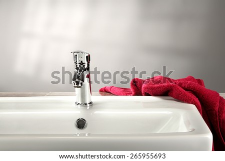 washbasin and red towel  - stock photo