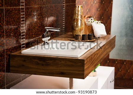 washbasin with counter in modern bathroom - stock photo