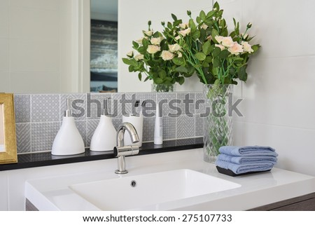 washbasin with faucet and liquid soap bottle at home - stock photo