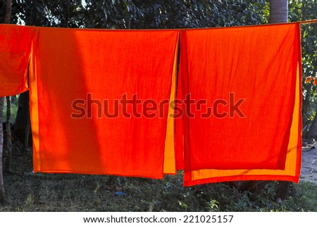 Washed and hung Clothes of buddhist Monks - stock photo
