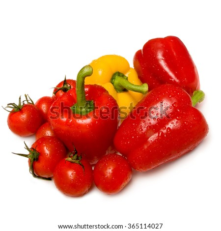 Washed red and yellow bell peppers and tomatoes; Food preparation; Wash before eating - stock photo