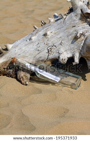 washed up message in a bottle on the beach - stock photo